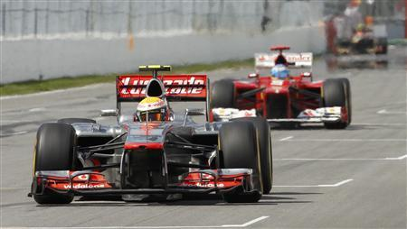 McLaren Formula One driver Lewis Hamilton of Britain leads Ferrari Formula One driver Fernando Alonso of Spain during the Canadian F1 Grand Prix at the Circuit Gilles Villeneuve in Montreal June 10, 2012. REUTERS/Luca Bruno/Pool