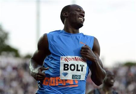 Usain Bolt of Jamaica celebrates winning the men's 100m race during the Diamond League athletics competition at the Bislett Stadium in Oslo June 7, 2012. REUTERS/Dylan Martinez