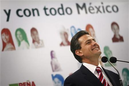 Enrique Pena Nieto, presidential candidate for the opposition Institutional Revolutionary Party (PRI), smiles during a news conference in Mexico City April 8, 2012. REUTERS/Edgard Garrido