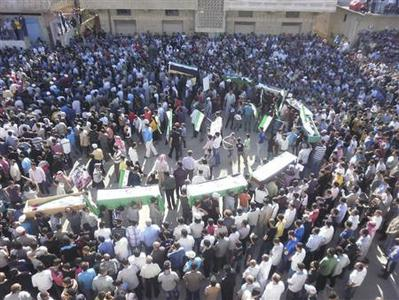 Syrian residents carry the bodies of people whom protesters say were killed by forces loyal to Syria's President Bashar al-Assad, during their funeral in Deraa June 9, 2012. REUTERS/Handout