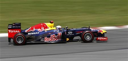 Red Bull Formula One driver Sebastian Vettel of Germany drives during the Canadian F1 Grand Prix at the Circuit Gilles Villeneuve in Montreal June 10, 2012. REUTERS/Chris Wattie