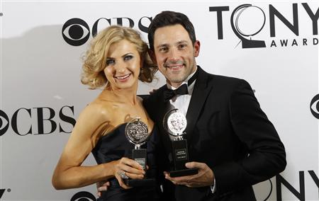 Nina Arianda (L) and Steve Kazee pose backstage with their awards during the American Theatre Wing's 66th annual Tony Awards in New York June 10, 2012. REUTERS/Andrew Burton