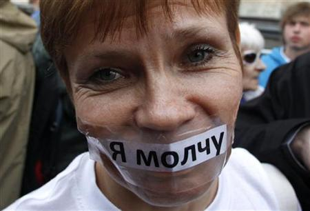 An opposition activist attends a protest rally to defend Article 31 of the Russian constitution, which guarantees the right of assembly, in Moscow May 31, 2012. The sheet of paper attached to the woman's face reads ''I keep silent''. REUTERS/Maxim Shemetov