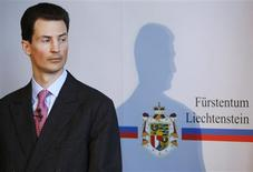 Crown Prince Alois von und zu Liechtenstein listens during a news conference in Vaduz in this March 12, 2009 file photo. REUTERS/Christian Hartmann/Files