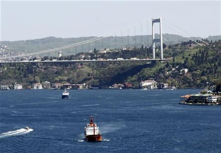 Oil tankers sail under the Fatih Sultan Mehmet Bridge linking the city's European and Asian sides, over the Bosphorus waterway in Istanbul April 26, 2012. REUTERS/Osman Orsal