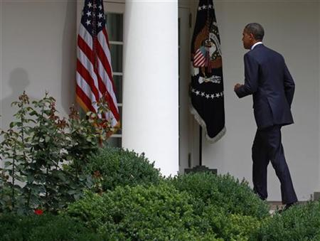 U.S. President Barack Obama walks back to the Oval Office after making remarks about the leaked Afghan war documents in the Rose Garden at the White House in Washington, July 27, 2010. REUTERS/Jim Young