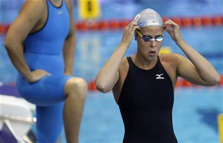 Federica Pellegrini of Italy adjusts her cap before competing in the women's 400m freestyle heats during the 2012 European Swimming Championships in Debrecen May 27, 2012. REUTERS/Laszlo Balogh
