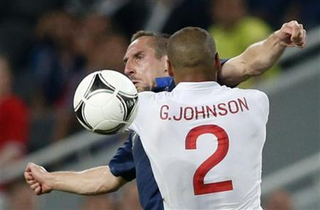 France's Franck Ribery and England's Glen Johnson (R) fight for the ball during their Group D Euro 2012 soccer match at the Donbass Arena in Donetsk, June 11, 2012. REUTERS/Michael Buholzer