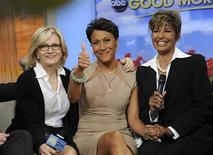 "Robin Roberts (C) gives a thumbs up as she discusses her medical condition with Diane Sawyer (L) and Sally Ann Roberts on ABC's ""Good Morning America"" program in this handout photo released June 11, 2012. REUTERS/Ida Mae Astute/ABC/Handout"