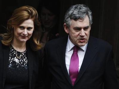Britain's former Prime Minister Gordon Brown and wife Sarah leave the Leveson Inquiry at the High Court in London, June 11, 2012. REUTERS/Luke MacGregor