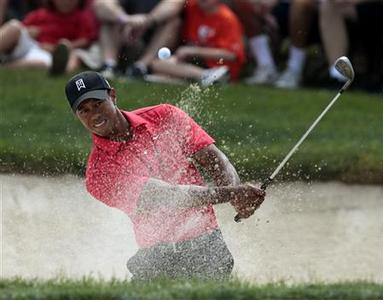 Tiger Woods of the U.S. hits from the sand on the 10th hole during the final round of the Memorial Tournament at Muirfield Village Golf Club in Dublin, Ohio June 3, 2012. REUTERS/John Sommers II