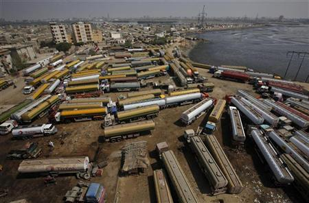 Fuel tankers, which are used to carry fuel for NATO forces in Afghanistan, are seen parked at a compound in Karachi April 13, 2012. REUTERS/Athar Hussain