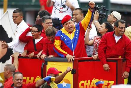 Venezuela's President Hugo Chavez (C) acknowledges supporters before the registration of his presidential bid to the electoral authorities in Caracas June 11, 2012. REUTERS/Carlos Garcia Rawlins