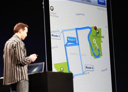 Scott Forstall, senior vice president of iOS Software at Apple Inc., demonstrates turn-by-turn navigation in iOS6 using Siri during the Apple Worldwide Developers Conference 2012 in San Francisco, California June 11, 2012. REUTERS/Stephen Lam