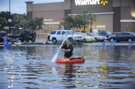 Robby Mandel, 16, makes his way through a parking lot in the Warrington area of Pensacola, Florida, June 9, 2012. REUTERS/Michael Spooneybarger