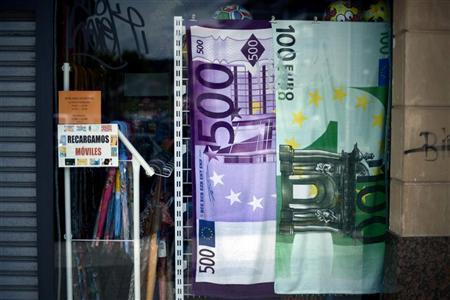 Beach towels with Euro note designs hang in a shop in Plentzia, 26 km (15 miles) from Bilbao June 8, 2012. REUTERS/Vincent West