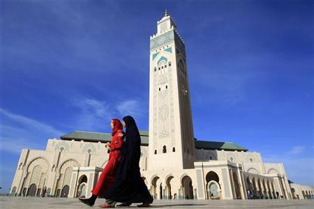 Moroccan women walk past the Hassan II mosque in Casablanca February 24, 2011. REUTERS/Pascal Rossignol