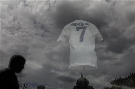 A man is reflected in the window with jerseys printed with the name of Ukrainian's national soccer team player Andriy Shevchenko in Kiev June 12, 2012. Ukraine won their first match of the Euro 2012 soccer championships against Sweden and Shevchenko scored two goals. REUTERS/Alexander Demianchuk