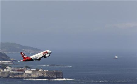 A plane from TAM Airlines flies over Fortress Sao Luis after leaving Santos Dumont airport in Rio de Janeiro September 28, 2011. REUTERS/Sergio Moraes