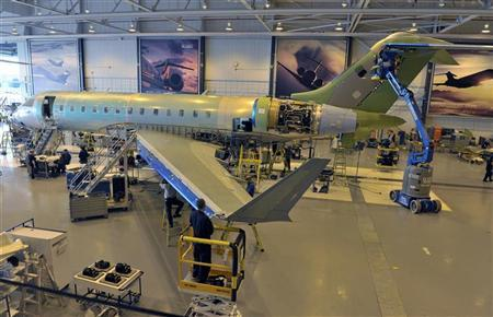 Bombardier employees install parts on a Global 6000 aircraft at the manufacturing facilities in Toronto May 29, 2012. REUTERS/Mike Cassese