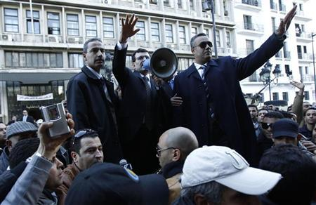 Tunisia's Interior Minister Ali Larayedh (C) speaks during a demonstration in Tunis January 11, 2012. Protesters were demanding the departure of corrupt police officers. REUTERS/Zoubeir Souissi