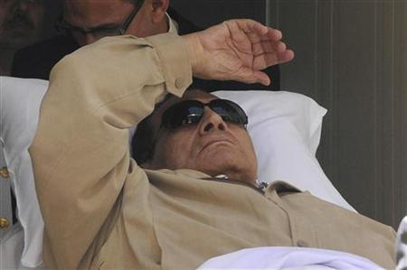 Former Egyptian President Hosni Mubarak is wheeled out of the courtroom after his trial in Cairo June 2, 2012. REUTERS/Stringer