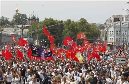 Participants march with flags and placards during an anti-government protest in Moscow June 12, 2012. REUTERS/Denis Sinyakov