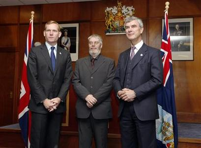 British Foreign and Commonwealth Minister of State Jeremy Browne (L), Gavin Short, Chairman of the Falkland Islands Legislative Assembly (C) and Falklands Islands Governor Nigel Haywood, pose after a meeting at the Town Hall in Stanley, Falkland Islands June 12, 2012. REUTERS/Enrique Marcarian