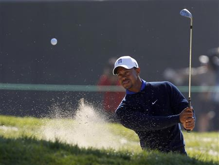 Tiger Woods of the U.S. chips to the seventh green during a practice round for the 2012 U.S. Open golf championship on the Lake Course at the Olympic Club in San Francisco, California June 12, 2012. REUTERS/Matt Sullivan
