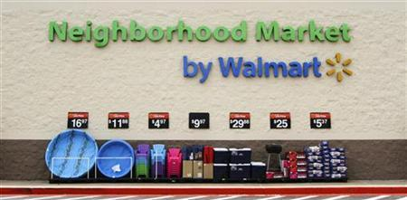 Products are displayed outside a Wal-Mart Neighborhood Market store in Bentonville, Arkansas, May 31, 2012. REUTERS/Jacob Slaton