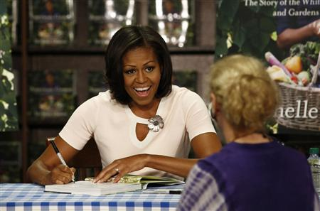 U.S. first lady Michelle Obama attends a book signing of her first book ''American Grown: The Story of the White House Kitchen Garden and Gardens Across America,'' at a book store in Washington June 12, 2012. REUTERS/Jason Reed