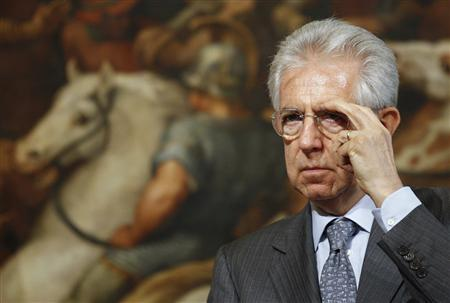 Italy's Prime Minister Mario Monti adjusts his eyeglasses during a news conference with Switzerland's President Eveline Widmer-Schlumpf (not pictured) at the Chigi palace in Rome June 12, 2012. REUTERS/ Max Rossi