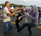 A Russian soccer fan fights with a Polish supporter (L) in Warsaw June 12, 2012. REUTERS/Peter Andrews