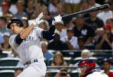 New York Yankees Alex Rodriguez hits a grand slam to tie the game in the eighth inning of play against the Atlanta Braves at their MLB Interleague baseball game at Turner Field in Atlanta, Georgia June 12, 2012. REUTERS/Tami Chappell