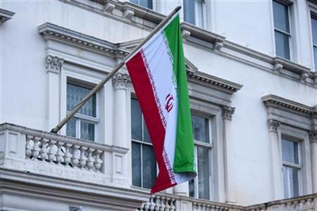 Iran's flag is seen hanging from the Iranian Embassy in central London November 30, 2011. REUTERS/Neil Hall