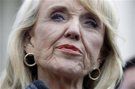 Arizona Governor Jan Brewer is pictured as she speaks to the press outside the U.S. Supreme Court in Washington, April 25, 2012, following arguments in the Arizona vs United States immigration enforcement law case. REUTERS/Jason Reed