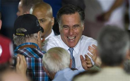 Republican presidential candidate and former Massachusetts governor Mitt Romney greets supporters at the end of a campaign rally at Con-Air Industries Inc. in Orlando, Florida, June 12, 2012. REUTERS/Steve Nesius