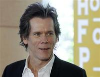 Actor Kevin Bacon arrives for the Hollywood Foreign Press Association Annual Installation Luncheon in Beverly Hills, California August 4, 2011. REUTERS/Fred Prouser