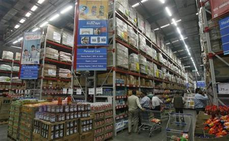 Customers shop at a Best Price Modern Wholesale store, a joint venture of Wal-Mart Stores Inc and Bharti Enterprises, at Zirakpur in Punjab November 24, 2011. REUTERS/Ajay Verma/Files