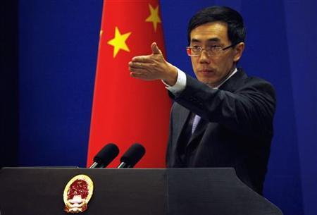 China's Foreign Ministry spokesman Liu Weimin gestures to a journalist during a news conference in Beijing November 21, 2011. REUTERS/David Gray
