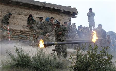 An Afghan National Army soldier fires a recoilless rifle towards Taliban positions from Blocking Position one above Kamdesh in Afghanistan's Nuristan Province June 11, 2012. U.S. troops returned to the area in Afghanistan they call the ''dark side of the moon'' this week, a remote Hindu Kush region that controls several access routes to Kabul and where the coalition suffered one of its biggest reverses in the decade-long war. REUTERS/Tim Wimborne