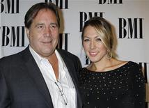 Singer and songwriter Colbie Caillat arrives with her father Ken Caillat at the 59th Annual BMI Pop Awards in Beverly Hills, California May 17, 2011. REUTERS/Fred Prouser