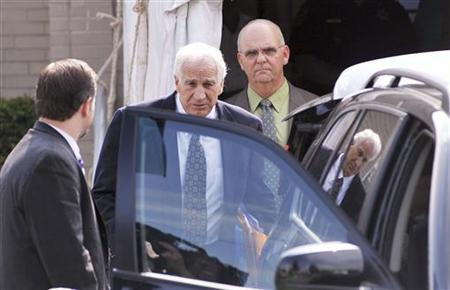 Former Penn State assistant football coach Jerry Sandusky leaves the Centre County Courthouse after the second day of his child sex abuse trial in Bellefonte, Pennsylvania June 12, 2012. REUTERS/Pat Little