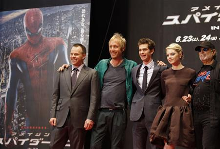 Director Marc Webb (L) poses with cast members Rhys Ifans (2nd L), Andrew Garfield (C) and Emma Stone and producer Avi Arad at the world premiere of ''The Amazing Spider-Man'' in Tokyo June 13, 2012. REUTERS/Yuriko Nakao
