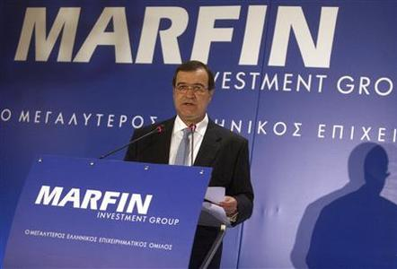 Marfin Investment Group (MIG) Chairman Andreas Vgenopoulos addresses journalists during news a conference in Athens, June 22, 2009. REUTERS/Icon