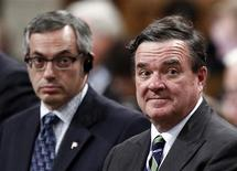 Canada's Finance Minister Jim Flaherty (R) and Treasury Board President Tony Clement stand to vote in the House of Commons on Parliament Hill in Ottawa June 12, 2012. REUTERS/Chris Wattie
