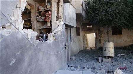 REFILE - CORRECTING GRAMMAR Damage is seen after shelling at the Talbisah area in Homs city June 13, 2012. REUTERS/Shaam News Network/Handout