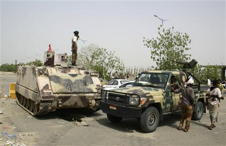 Military vehicles are seen on a street in the southern Yemeni city of Jaar June 13, 2012. Yemen on Wednesday pressed ahead with a U.S.-backed offensive to drive al Qaeda-linked insurgents from the country's south, a day after the army notched up its biggest victory in more than a year by recapturing two strategic cities. REUTERS/Stringer