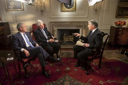 Former U.S. Presidents Bill Clinton (C) and George W. Bush (2nd L) are interviewed by CNN's John King in the Map Room of the White House, in this photo released by CNN and taken January 16, 2010. REUTERS/White House/Lawrence Jackson/Handout