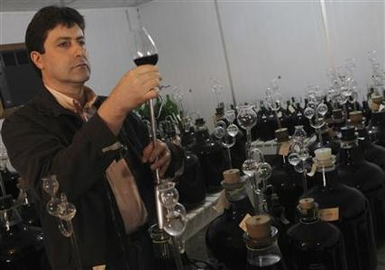 Enologist Celito Guerra takes wine samples to analyze during a tour of a winery in Bento Goncalves, in the southern state of Rio Grande do Sul, May 9, 2012. REUTERS/Edison Vara